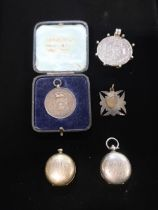 Hallmarked Sterling silver coin brooch, two Hallmarked Sterling silver sovereign cases gross 2.25ozt