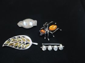 Collection of brooches including Spider with amber set in silver mount stamped 925, another in the