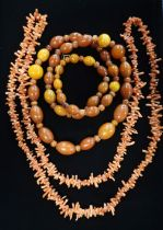Graduated butterscotch amber beaded necklace L80cm 69.6g and a Coral necklace in a painted red box