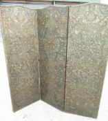 Early C20th two fold screen, the three arched panels with brass nailed embossed and painted