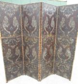 Victorian three fold screen, the four brass nailed panels painted with renaissance scroll work,