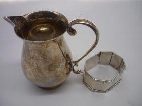 Geo.V hallmarked silver sparrow beak cream jug, Birmingham 1938 and an octagonal napkin ring,