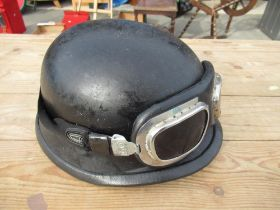 Black fibreglass military style helmet with associated goggles
