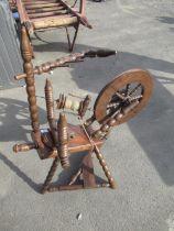 Victorian style oak spinning wheel on bobbin turned tripod base