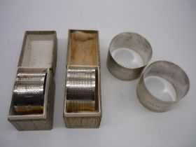 Pair of Geo.VI hallmarked engine turned silver napkin rings, Birmingham 1928, boxed and a similar
