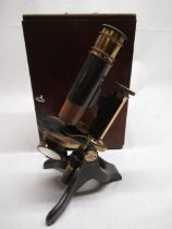 Black japanned and brass monocular microscope by EG Wood, 74 Cheapside London, with screw fine
