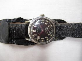 WWII Wehrmacht Revue Sport military hand wound wristwatch. Plated case on military style black