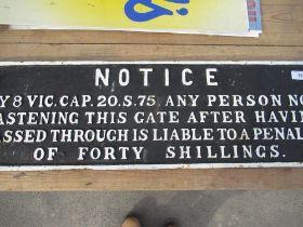 Heavy cast metal penalty gate close notice
