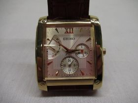 Seiko quartz wristwatch with day, date and 24 hour indicator. Rectangular gold-plated case on