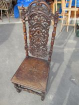 Early C20th oak hall chair with carved and pierced cresting rail, pierced and carved central splat