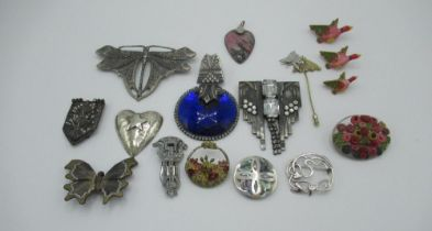 Collection of costume brooches including one abalone circular brooch with foreign stamp to back, a
