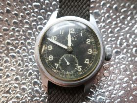 """WWII Timor """"Dirty Dozen"""" military issue wristwatch, stainless steel case on military style webbing"""