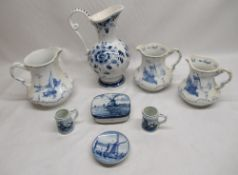 Delft ware jugs, miniature mugs, butter dish and saucer etc (8)