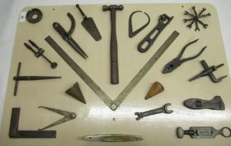 Mounted montage of vintage tools including square dividers, ball pen hammer, folding steel rule 45cm