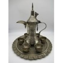 Middle Eastern silver plated coffee set comprising of a coffee pot, six cups and a serving tray