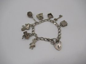 Sterling silver charm bracelet including charms of Holy Bible, warming pan, boot, teddy etc with