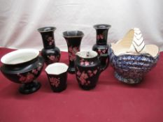 Six pieces of black Carlton Ware with apple blossom design including vases, water jug etc, an Arthur