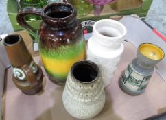 four pieces of West German pottery including a green, brown and yellow jug, small brown jug,