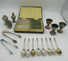 Cased set of five green handled knives, eight apostle tea spoons, salt and pepper set, two pairs