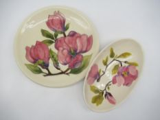 Moorcroft pottery oval dish, decorated with pink flowers and branch work on an ivory ground,