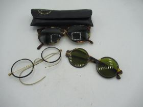 Tortoiseshell Ray Bans, pair of green lens sunglasses and another pair of spectacles