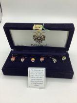 Fabergé guilloche enamel wine charms, edition I arrow head egg, in dark blue velvet case with