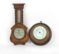 Property of a deceased estate - a brass cased bulkhead aneroid barometer, mounted on an oak roundel,