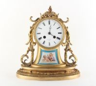 Property of a gentleman - a late 19th century French porcelain mounted ormolu cased mantel clock,