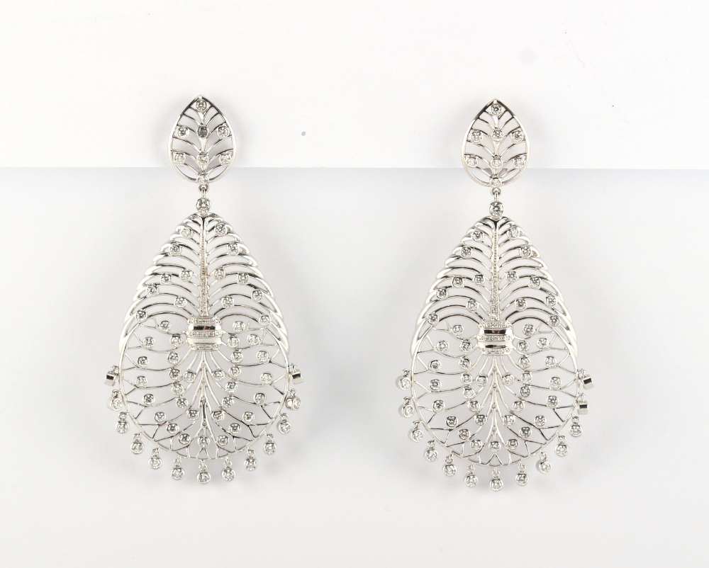 A large pair of 18ct gold diamond openwork earrings, of stylised veined leaf design set with diamond