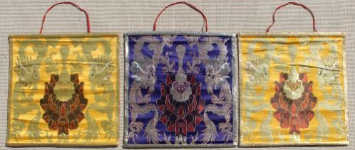 A set of three Tibetan embroidered silk & metal thread wall hangings, each 26.8 by 25.4ins. (68 by