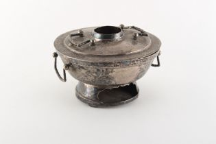 An early 20th century Chinese or Tibetan silver food warmer or hot pot, 6.7ins. (17cms.) diameter.