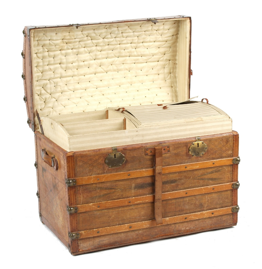 Property of a deceased estate - a late 19th century tooled leather domed top trunk with fitted