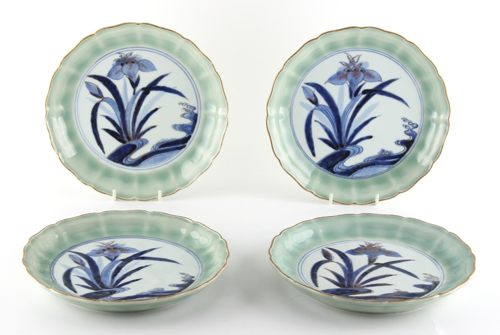 Property of a lady - a set of four Japanese Arita blue and white & celadon shallow dishes, 18th /
