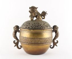 A large bronze censer, 19th century, the pierced cover with temple lion finial, previously with
