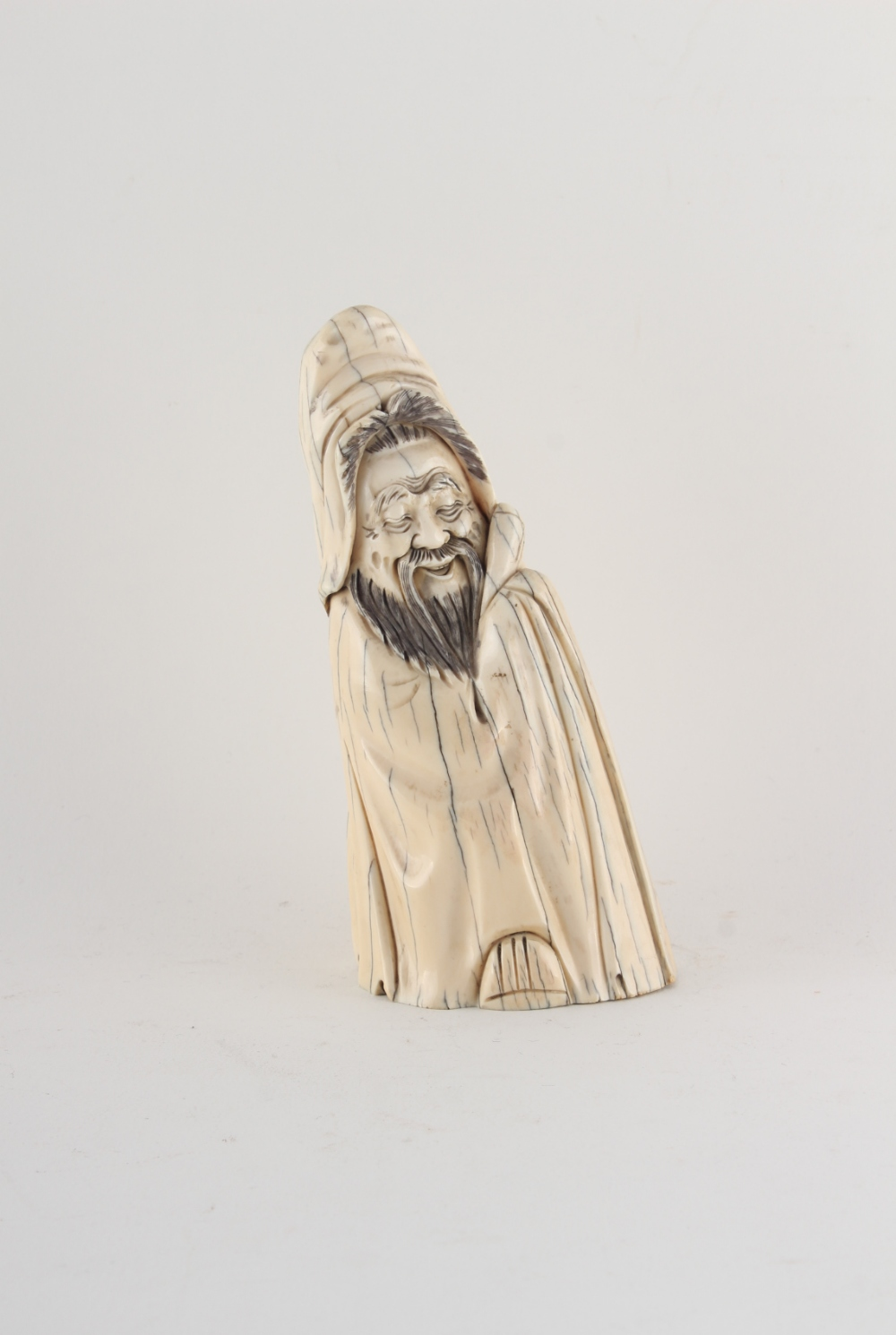 Property of a gentleman - a Chinese carved walrus ivory figure of a sage, early 20th century,