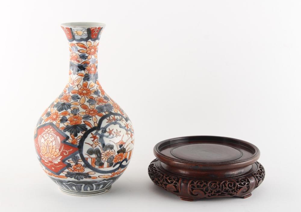 Property of a gentleman - a 19th century Japanese Imari bottle vase, 9.1ins. (23.1cms.) high;
