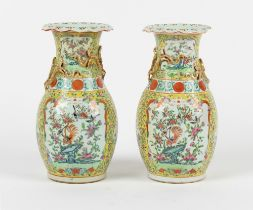 Property of a lady - a pair of late 19th century Chinese Canton famille rose baluster vases with