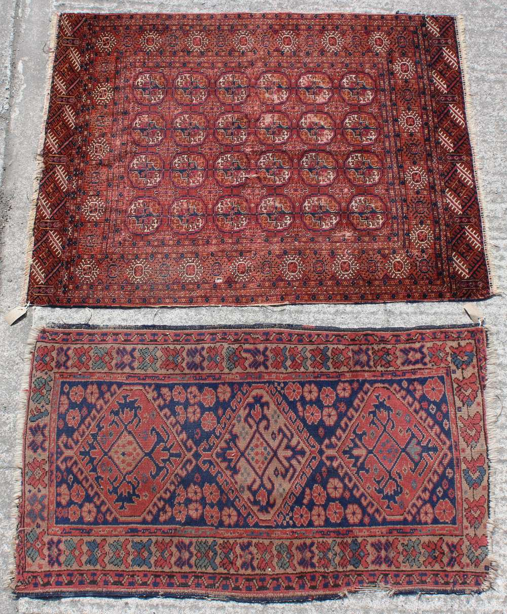 Property of a lady - a Turkoman rug with four rows of octagonal guls, 55 by 43ins. (140 by 109cms.);