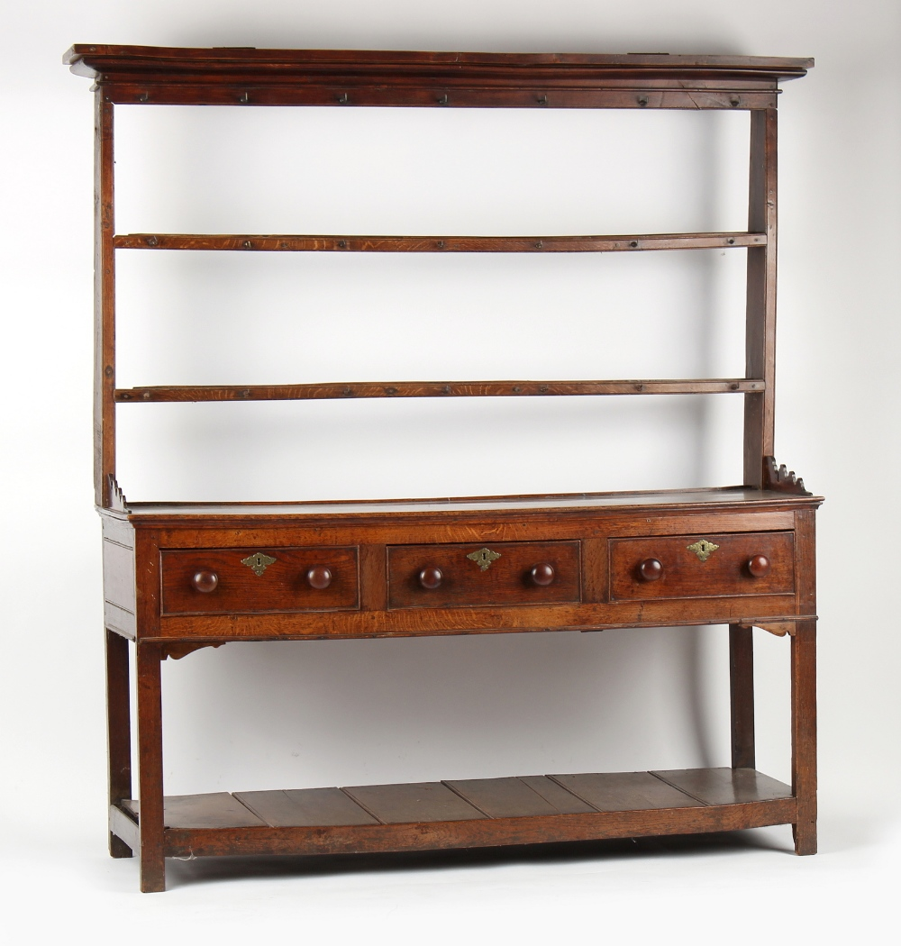Property of a lady - a George III oak two-part dresser with three drawers above pot board, 71ins. (