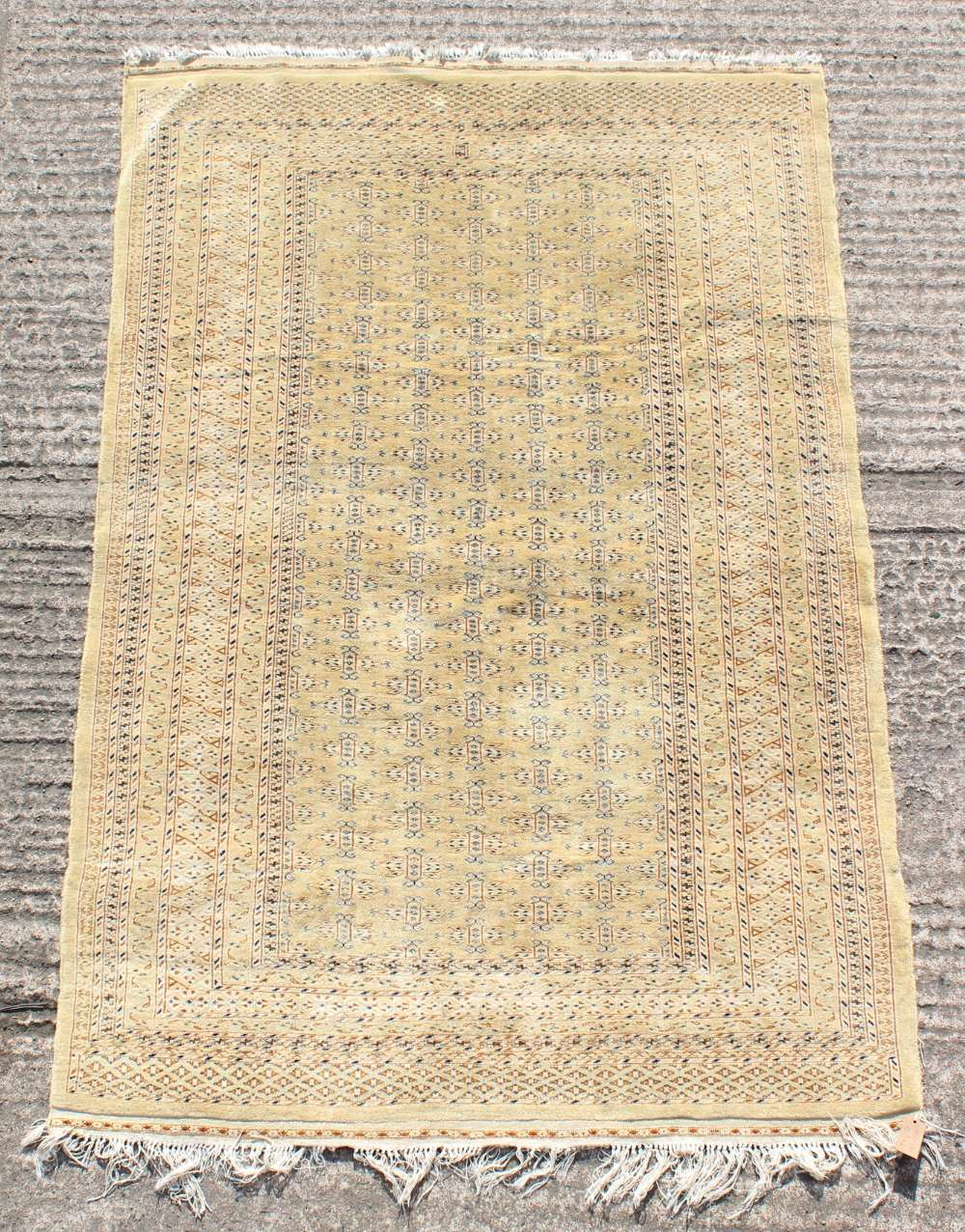 Property of a gentleman - a finely knotted Turkoman design rug with pale yellow ground, 74 by 51ins.