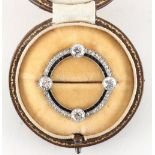 A good early 20th century Art Deco diamond & sapphire hoop brooch, set with four Old European cut