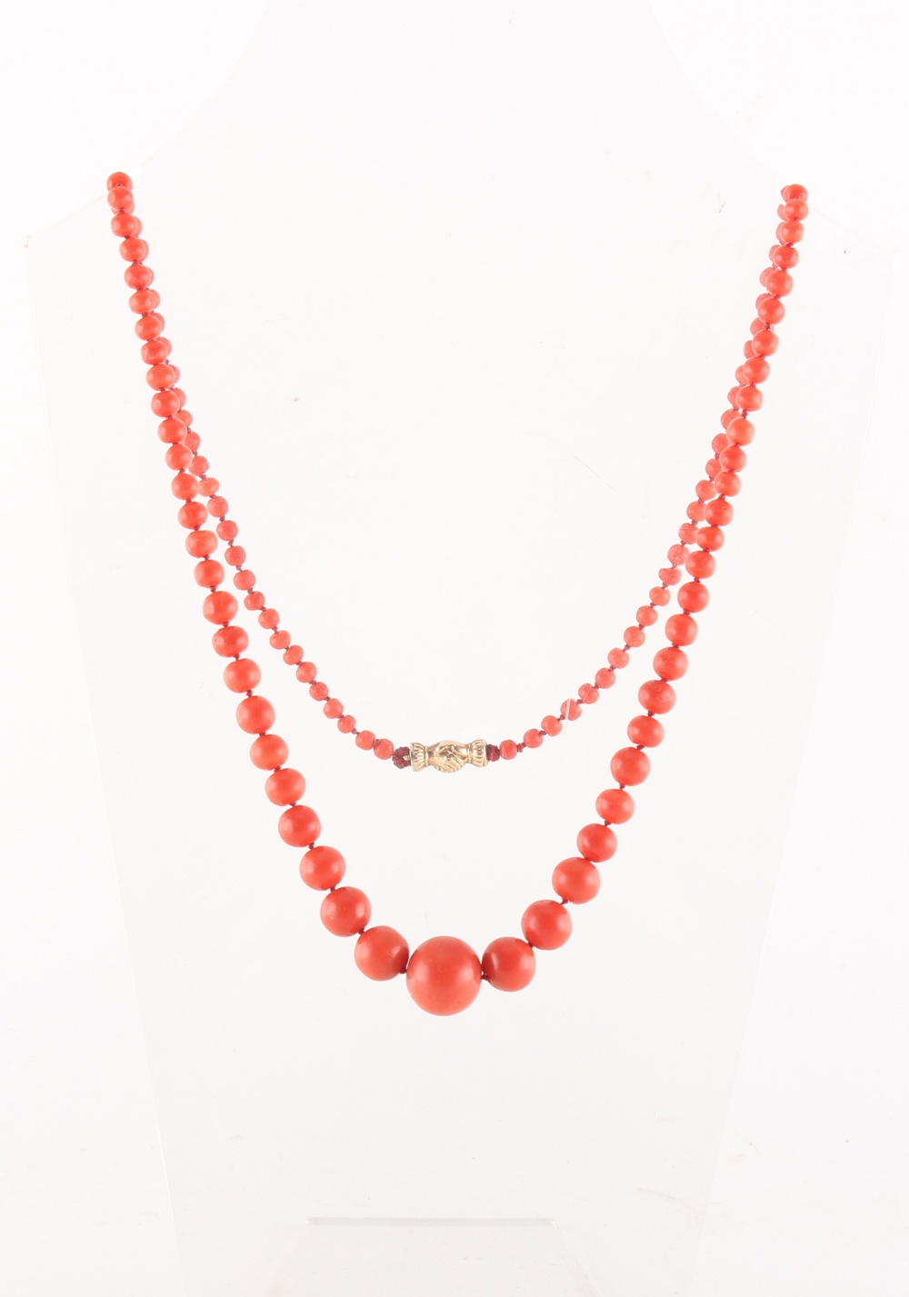 A coral graduated bead necklace, the largest bead approximately 14.5mm diameter, the unmarked gold