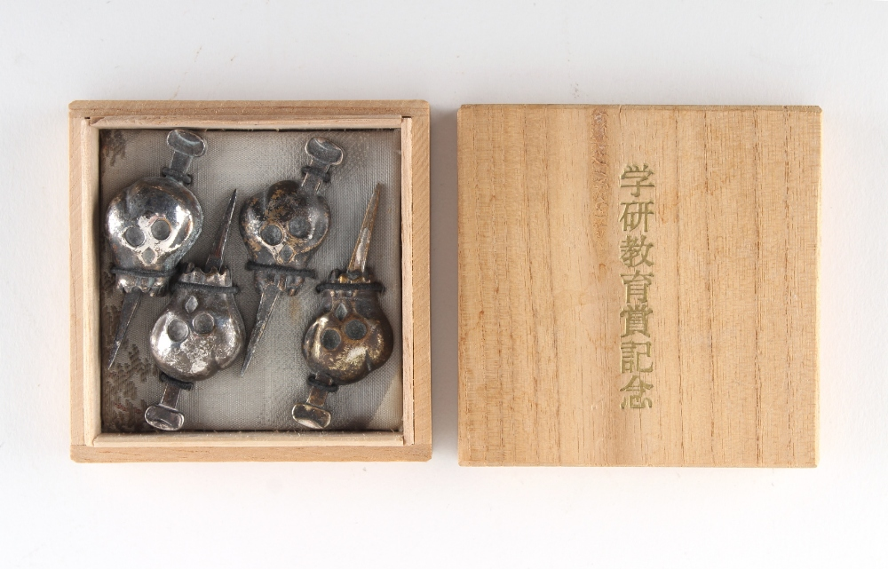 Property of a gentleman - two pairs of Japanese white metal menuki, boxed (4).