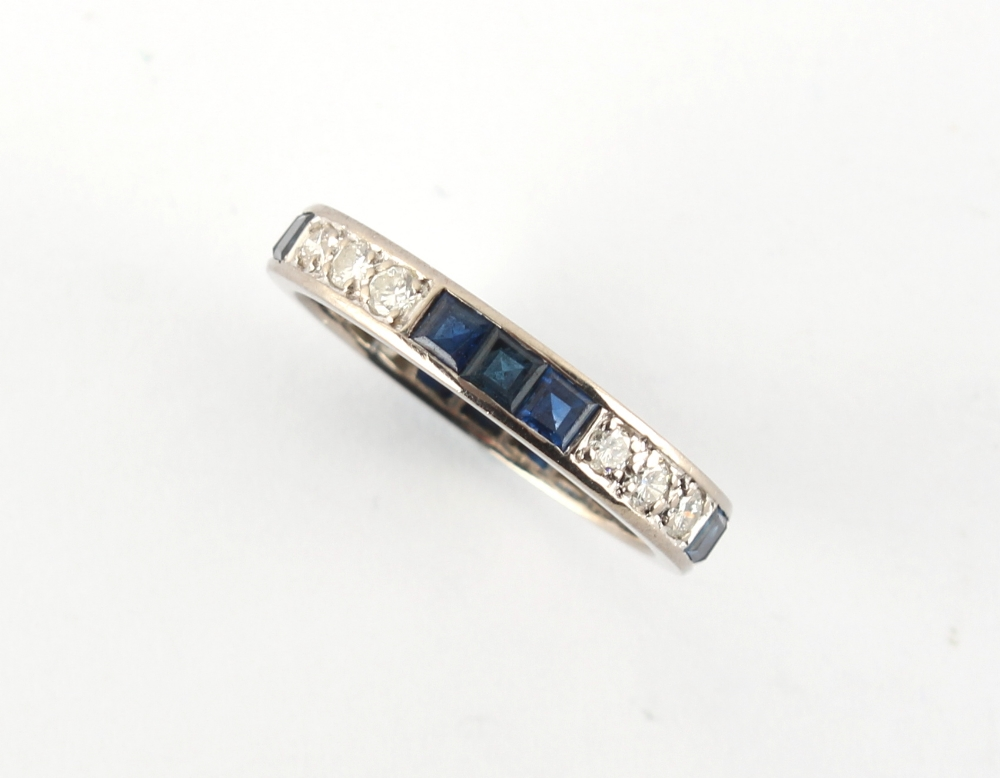 A platinum sapphire & diamond eternity ring, set with alternating rows of three square cut sapphires - Image 2 of 2
