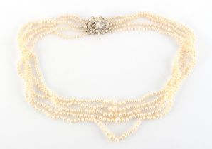 A fine natural pearl five strand necklace, with unmarked yellow gold navette shaped clasp set with