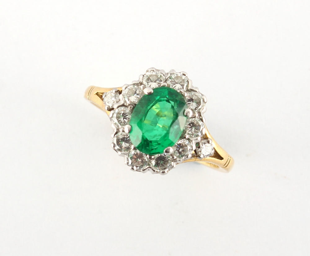 An 18ct yellow gold emerald & diamond oval cluster ring, the vibrant & clear oval cushion cut - Image 2 of 2