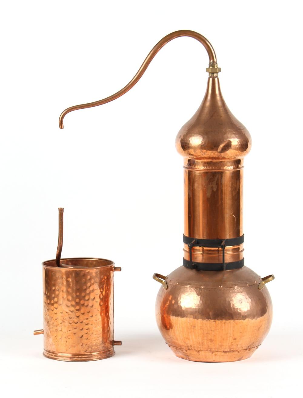 A copper alembic perfume still, 42.5ins. (108cms.) high. Provenance - L'Occitane, Salisbury.