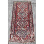 Property of a gentleman - an antique Caucasian Kazak rug, 98 by 48ins. (249 by 122cms.).
