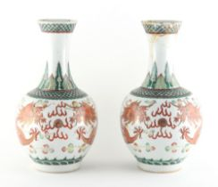 Property of a lady - a pair of late 19th century Chinese dragon vases, underglaze blue apocryphal