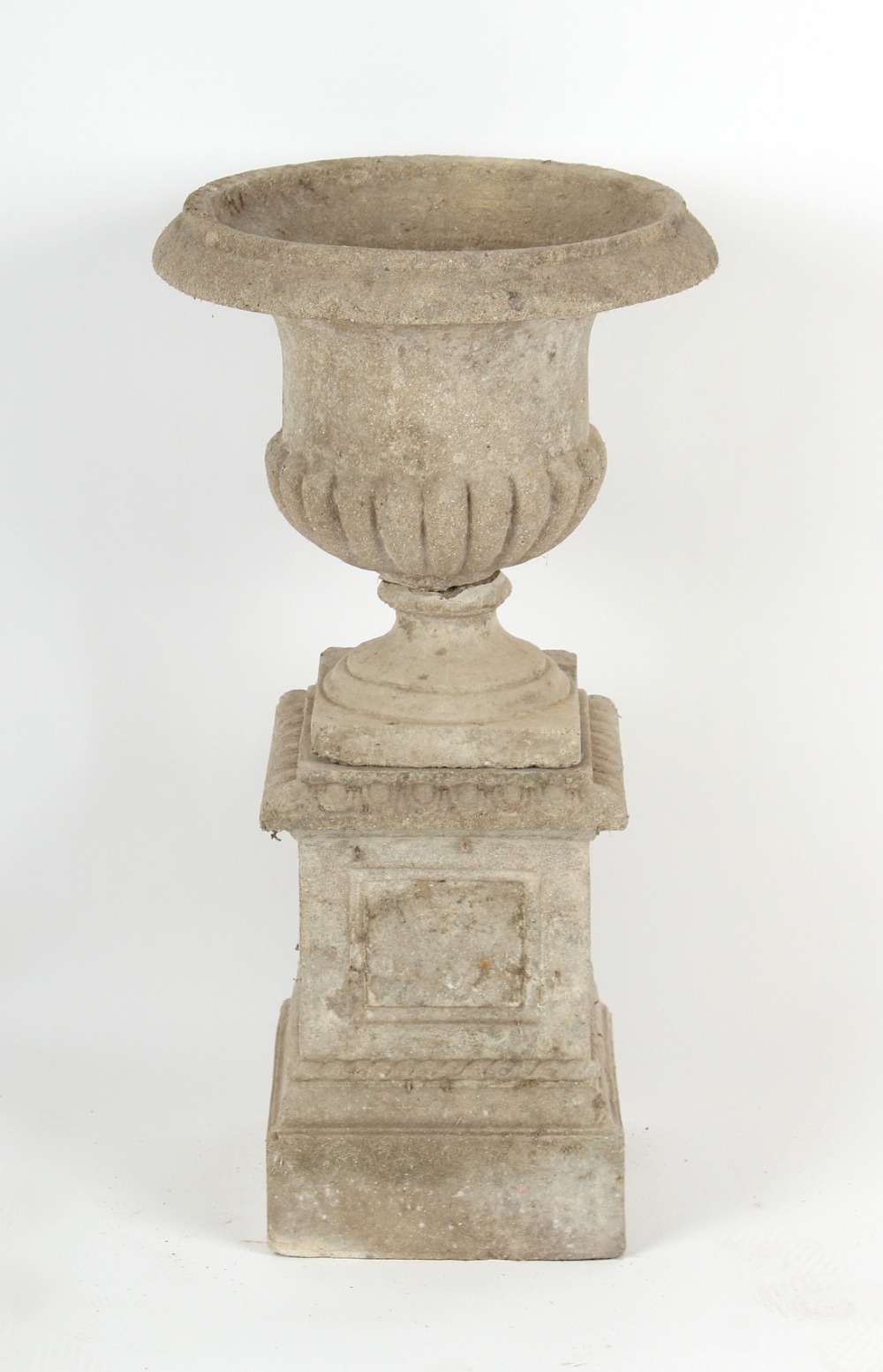 Property of a deceased estate - a reconstituted stone garden urn on plinth base, 31ins. (79cms.)